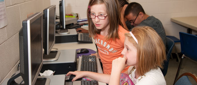 Girls Working at the Computer