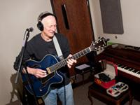 GCC Recording Studio playing guitar