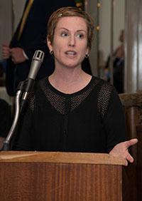VanLone speaking at the podium