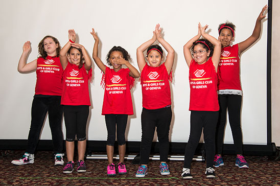 A group of young children show off their dance routine